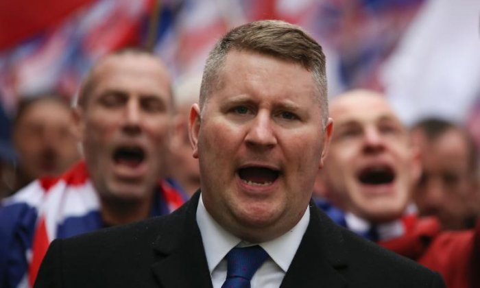 Paul Golding claims to have been arrested outside a court in Belfast