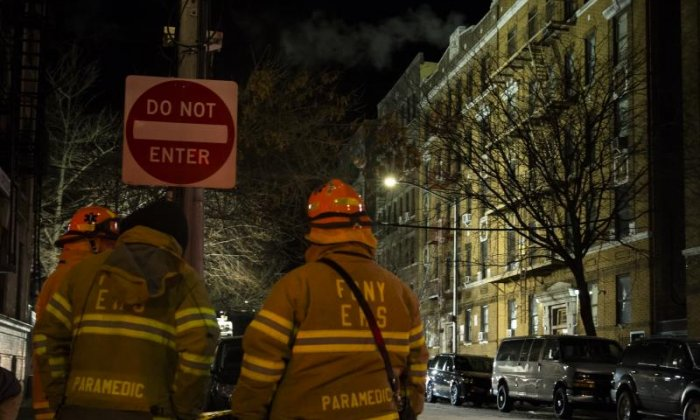 Firefighters are seen at the scene of the fire which broke out in the Bronx last week. A second fire has now erupted in the New York neighbourhood