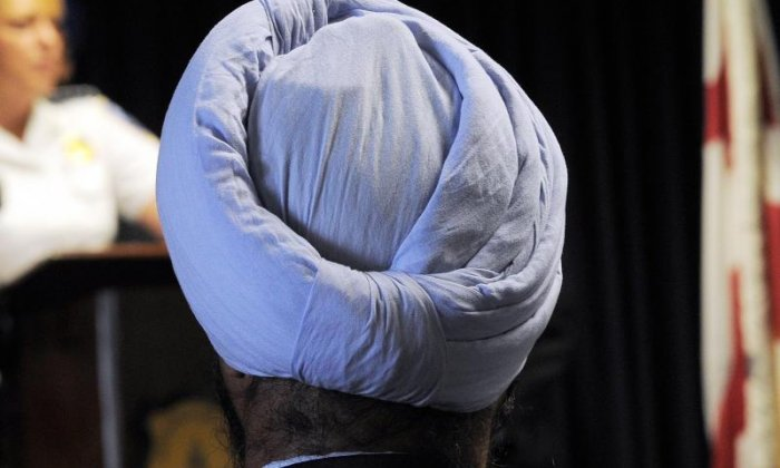 Sikh claims man who tried to pull off his turban said 'Muslim go back' during racist attack