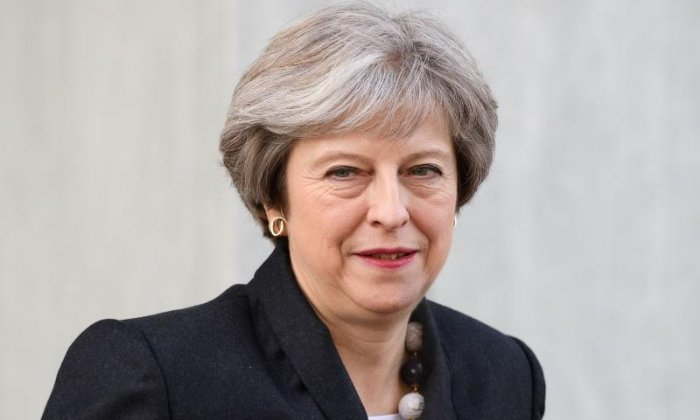 Theresa May to praise 'heroism' of suffragettes but warn against abuse threatening democracy