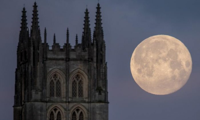 The moon next to Downside Abbey