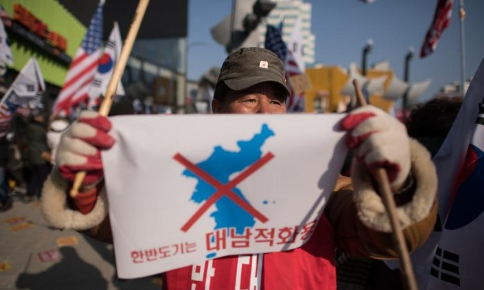 North Korean protestors burn flags and photos of Kim Jong-un at Winter Olympics