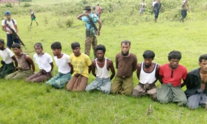 Myanmar holds two journalists after investigating Rohingya deaths