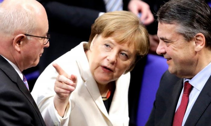 Merkel is leading a fragile coalition threatened on both sides