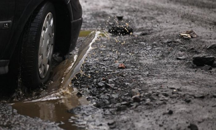 An estimated shortfall of £556m in 2017/18 meant roads are in poor condition, claims the report