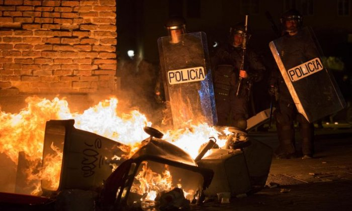 Protestors in Madrid clash with security forces over death of immigrant