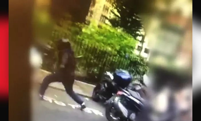 Hisham Tawfik can be seen swinging a hammer during the theft of a motorbike