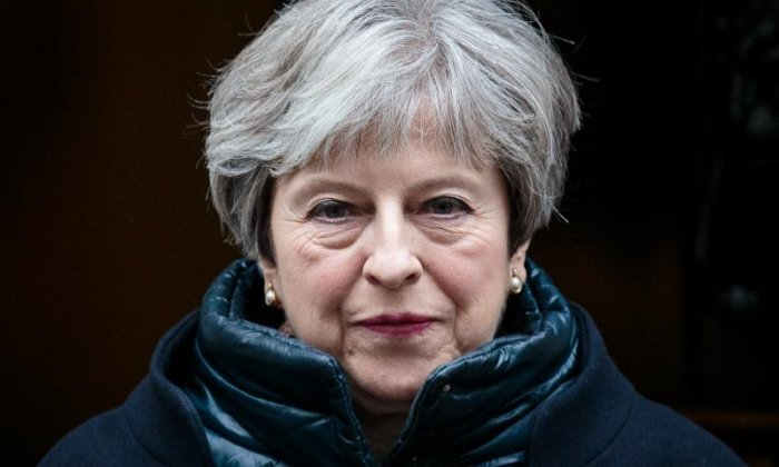Theresa May struck an optimistic but defiant note today