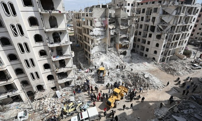 Syrian rescue teams clear the rubble yesterday morning (April 10) at the site of an explosion