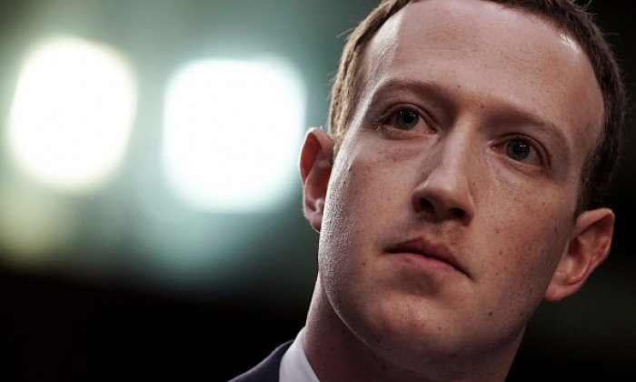 Facebook co-founder, chairman and CEO Mark Zuckerberg appearing on Capitol Hill