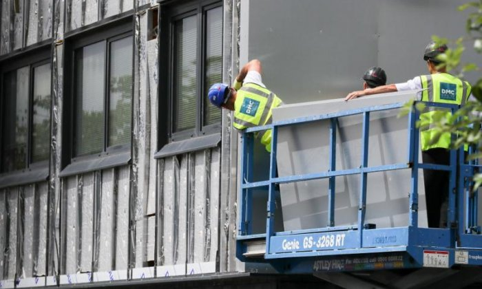 Cladding being removed from a London tower block