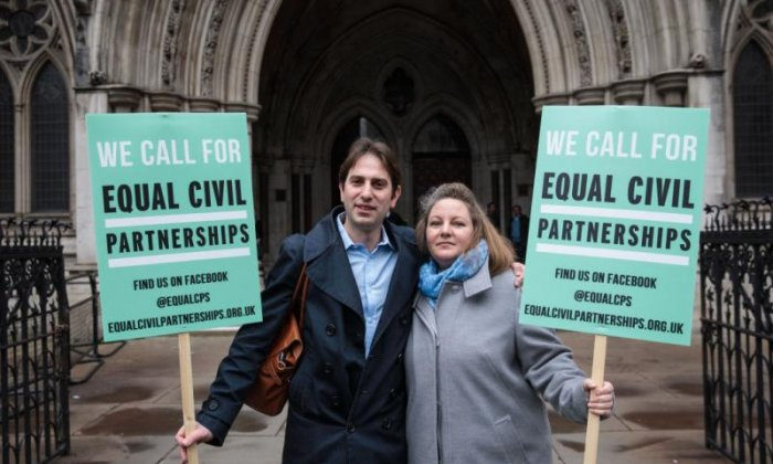 Theresa May announces law change to allow civil partnerships for opposite-sex couples