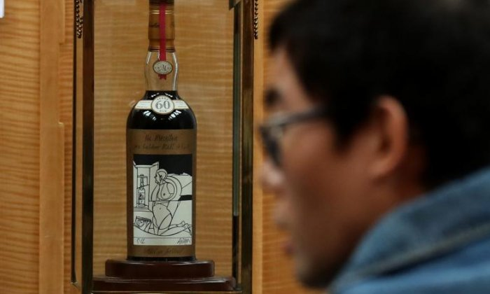 Rare bottle of whisky sells for almost £850,000 at auction