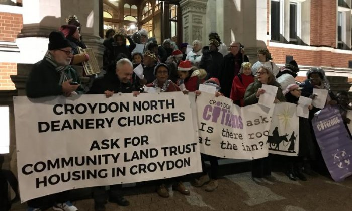 Campaigners perform a nativity and sing housing-themed carols to demand affordable housing