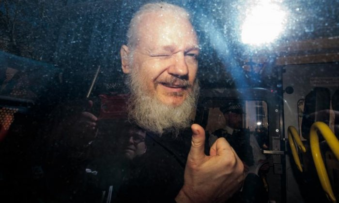 Assange pleads not guilty to failing to surrender to custody