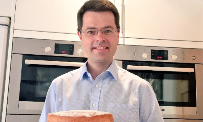 Housing minister criticised for having four ovens in his home