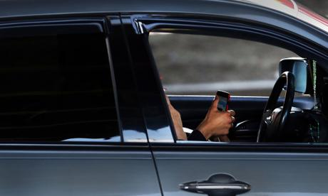 Texting while driving is the equivalent of being at twice the legal drink-drive limit, a road safety specialist has warned amid calls for all mobile phone usage to be banned for drivers