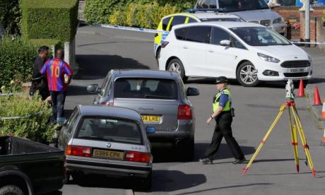 Police outside the property in Telford where Dalian Atkinson was tasered.