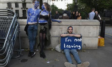 A young couple painted as EU flags protest outside Downing Street following the referendum on 23 June
