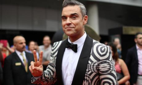 Robbie Williams gives his Brit Awards away and sent one to Wayne Rooney
