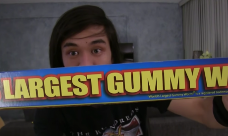 You won't be able to stop watching this man eat the world's largest gummy worm