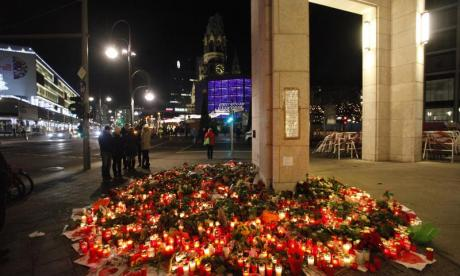 Mourners have laid flowers near the Christmas market which was attacked in Monday