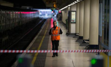 A Southern Rail employee stands on an empty platform during a recent strike