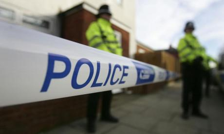 Two serving police officers arrested after drugs raids