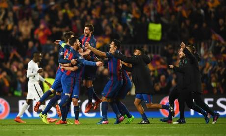 Barca players celebrate their incredible victory last night