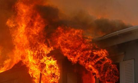 Man kills pregnant woman in fire after she complains about his smell