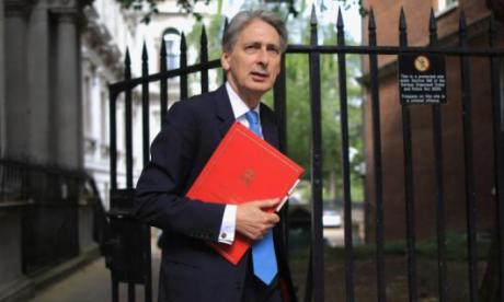 Philip Hammond has been savaged over the 'omnNICshambles'