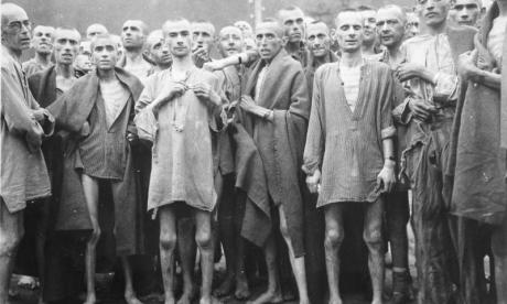 Inmates of a Nazi concentration camp are seen at the end of the Holocaust