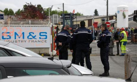 Employees booby-trap factory and threaten to blow it up if demands aren't met in France
