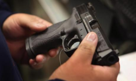 Woman asked friend to hide gun at home and seemingly joked about children finding it