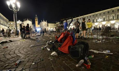 Woman dies after being crushed in stampede at Champions League screening in Italy