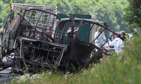 18 dead after coach collides with lorry and bursts into flames in Germany