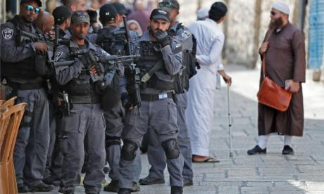 Israel removes additional security measures from Al-Aqsa Mosque as thousands cheer at funeral of Palestinian gunmen