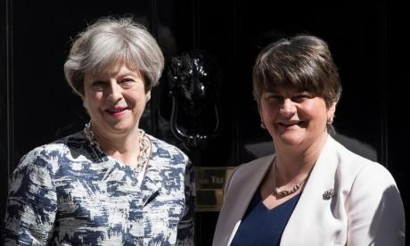 Theresa May was hugely criticised for her deal with Arlene Foster (r)