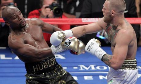 Floyd Mayweather overcame the challenge of a brave Conor McGregor on Saturday night