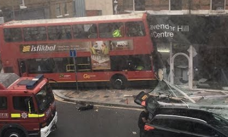 Bus driver taken to hospital after vehicle crashes in London's Lavender Hill