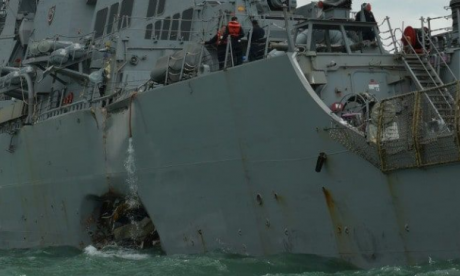 Oil tanker and US Navy vessel collide with each other near Singapore