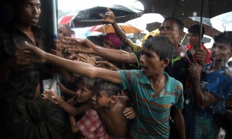 At least 12 dead and several missing after boat carrying Rohingya refugees sinks
