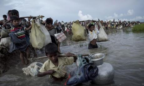 Rohingya refugees saved after trying to cross river using jerrycans to float
