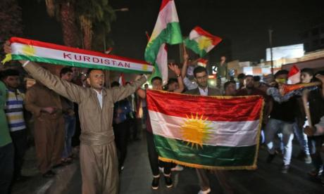 Kurds celebrate following last month's referendum