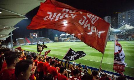 Hong Kong football supporters boo and swear during national anthem