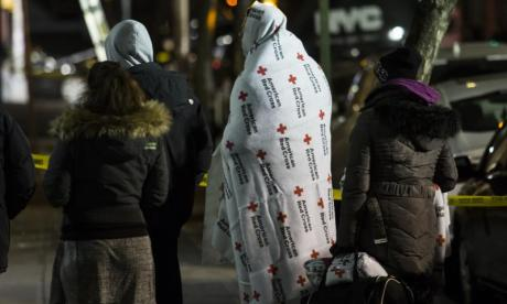 Evacuees are seen after the fire in New York