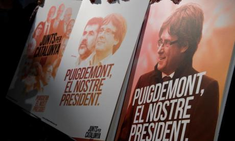 Carles Puigdemont, seen here on separatist posters, sent a bullish message to his former comrades this morning