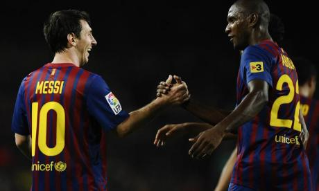 Eric Abidal (right) has now clarified his comments on Lionel Messi