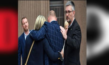 Barry Bennell's victims embrace after the former football coach was jailed for 31 years