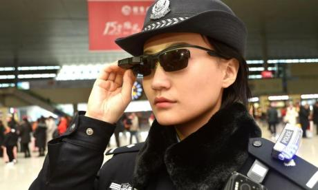 Chinese police officers use facial recognition glasses to find suspects